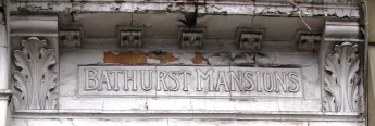 Photo of th estone carved lettering of Bathurst Mansions